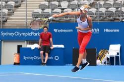 Caroline Wozniacki - practice session in Sydney 1/2/14