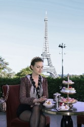 Leighton Meester in pantyhose eating in front of the Eiffel Tower from Gossip Girl
