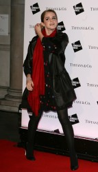 Emma Watson looking stunning and adorable in polkadot dress and pantyhose at the opening of the Somerset House ice rink in London 11/30/08