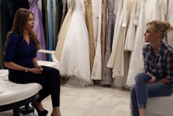 Julie Bowen in a wedding dress and Sofia Vergara screencaps from s5e17 of Modern Family