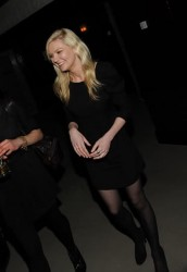 Kristen Dunst nice legs in pantyhose at the opening of Opening Ceremony and No. 8a for Fashion Week at Ace Hotel New York 2/17/10