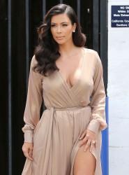Kim Kardashian showing off her legs leaving a Studio in Los Angeles 07-27-2014