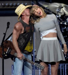 Taylor Swift - on stage with Kenny Chesney @ his Big Revival Tour in Nashville, TN 03/26/15
